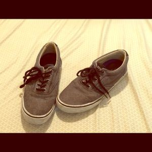 Grey and black sperry shoe with laces